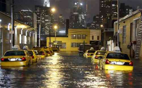 SUPERSTORM-SANDY- flooded taxi streetn in queens.jpg